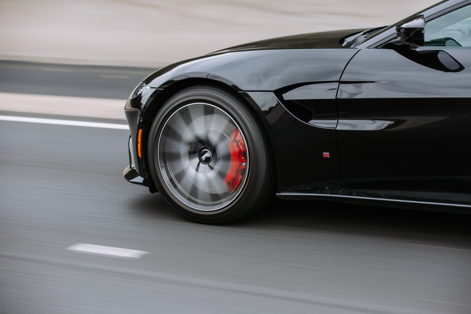 black coupe on road going fast